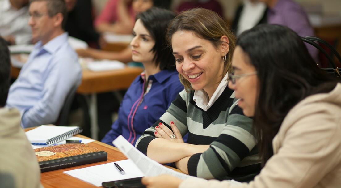 Women talking in class