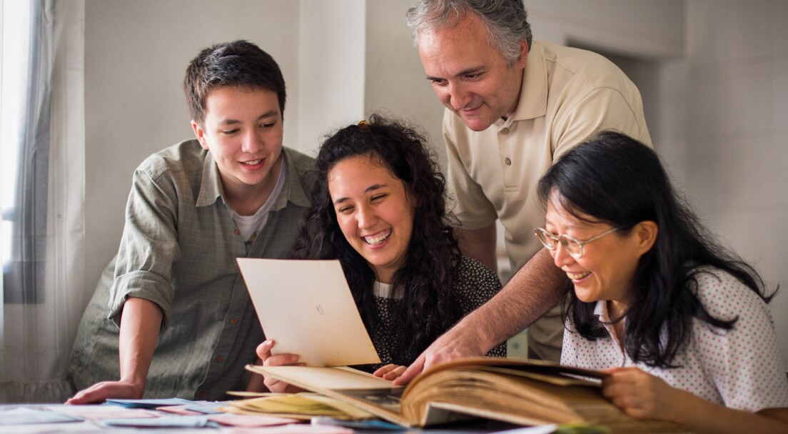 Smiling family doing family history research