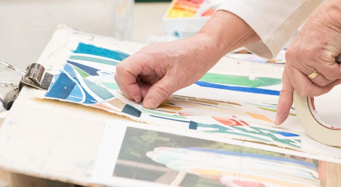 Hand pointing at artwork